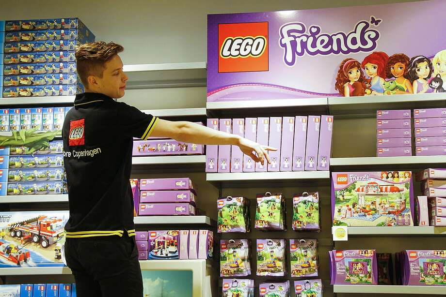 "An employee restocks display shelves with boxes of the ""Lego Friends"" series building blocks inside a Lego A/S toy store in Copenhagen, Denmark, on Friday, Jan. 11, 2013. The ""Lego Friends"" series, introduced in January in most markets, is Lego's sixth attempt over the years to target girls and the ""most significant"" new product in a decade, according to Chief Executive Officer Joergen Vig Knudstorp. Photographer: Freya Ingrid Morales/Bloomberg Photo: Freya Ingrid Morales, Bloomberg"