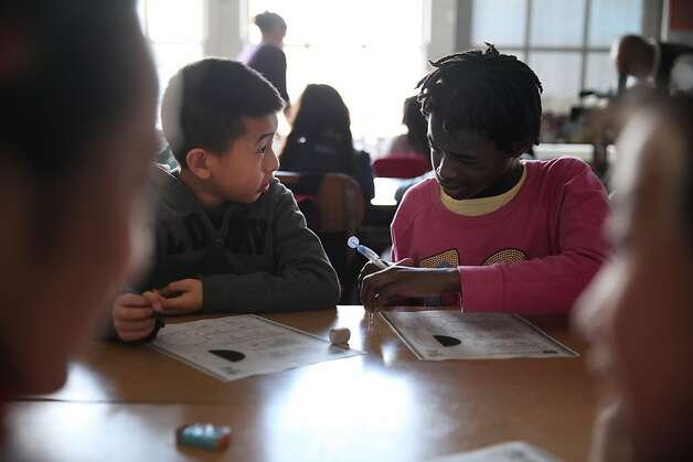 Fourth graders Christofer Kung,9 and Zuri Colas, 9 work together on a class assignment during class at Spring Valley Science School on Thursday, February 28, 2013 in San Francisco, Calif. Photo: Lea Suzuki, The Chronicle