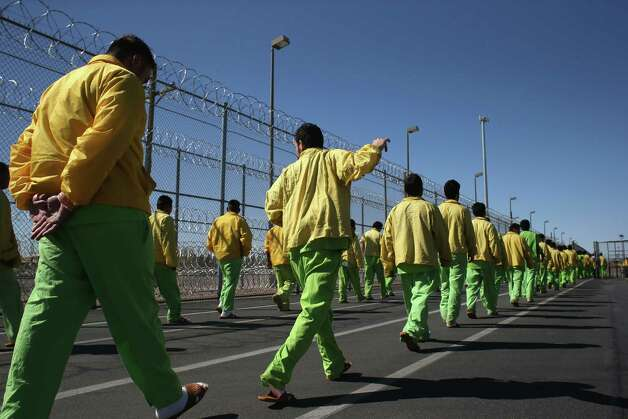 FLORENCE, AZ - FEBRUARY 28:  Immigrant detainees walk through the Immigration and Customs Enforcement (ICE), detention facility on February 28, 2013 in Florence, Arizona. With the possibility of federal budget sequestration, ICE released 303 immigration detainees in the last week from detention facilities throught Arizona. More than 2,000 immigration detainees remain in ICE custody in the state. Most detainees typically remain in custody for several weeks before they are deported to their home country, while others remain for longer periods while their immigration cases work through the courts.  (Photo by John Moore/Getty Images) Photo: John Moore, Getty Images / 2013 Getty Images