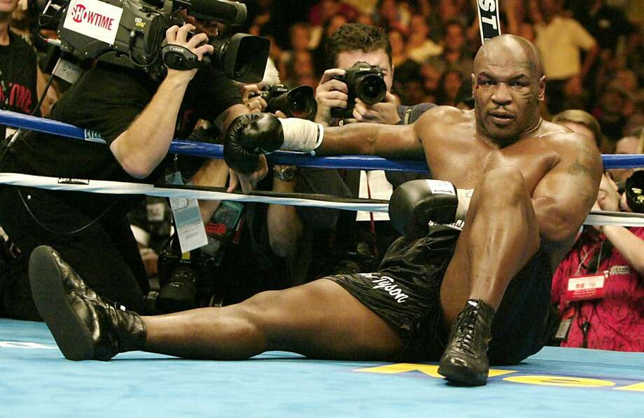 Mike Tyson of the United States sits on the canvas after being knocked out by Danny Williams of Great Britain, in their heavyweight fight in Louisville, late July 30, 2004. Williams scored an upset win over Tyson in their heavyweight fight late Friday. The unheralded Williams, 31, stopped Tyson, 38, in the fourth round to leave the former undisputed world champion's future in the sport in doubt.            REUTERS/Peter Jones  Ran on: 08-01-2004 Mike Tyson didn't appear eager to get up after being knocked down by Danny Williams in the fourth round. He stayed down.  Ran on: 08-01-2004   Ran on: 08-01-2004 Mike Tyson didn't appear eager to get up after being floored by Danny Williams in the fourth round Friday. He stayed down.  Ran on: 08-01-2004   Ran on: 08-01-2004   Ran on: 08-01-2004 Photo: Peter Jones, REUTERS
