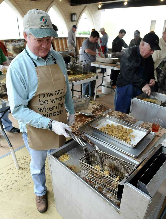 Montie Morgan fries oysters outside of the First United Methodist Church on Thursday, February 28, 2013, for the annual Oyster Supper. Photo taken: Randy Edwards/The Enterprise Photo: Randy Edwards