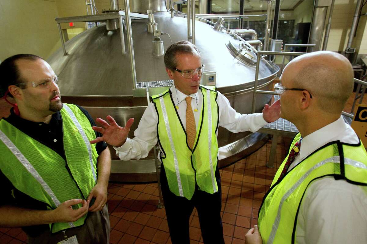 Lt. Gov. David Dewhurst, center, is flanked by brewmaster Dave Cohen, left, and Richard Wohlfarth, brewery general manager, during a tour of the Anheuser-Busch Houston Brewery Wednesday, Oct. 5, 2011, in Houston. The local Anheuser-Busch InBev brewery is using a major capital infusion from its corporate parent to reduce water usage and boost the amount of beer it can make by half a million barrels. ( Brett Coomer / Houston Chronicle )