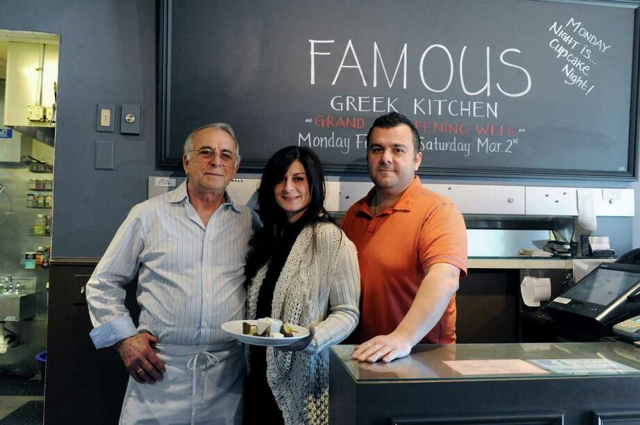 From left: Family owners, John Karipides, his daughter Maria Katsaros, and son Steve Karipides stand at their famous Greek Kitchen in Byram, Conn., Thursday, Feb. 21, 2013. Famous Greek Kitchen, a family-run restaurant which started over 30 years ago under a different name, is being reopened by the children of the original owners, with new décor and menu. Photo: Helen Neafsey / Greenwich Time