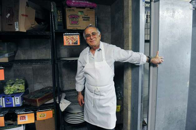 OwnerJohn Karipides stands in the cooler at Famous Greek Kitchen, in Byram, Conn.,Thursday, Feb. 21, 2013. The family-run restaurant which started over 30 years ago under a different name, is being reopened by the children of the original owners, with new décor and menu. Photo: Helen Neafsey / Greenwich Time