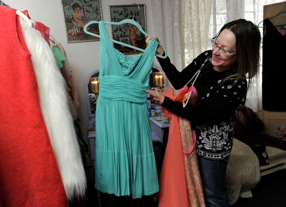 Danbury resident, Debra Murphy, of Danbury, the owner of Harlowe's Vintage of Newtown shows off one of the vintage dresses from her collection, Tuesday, Feb. 19, 2013. Photo: Carol Kaliff / The News-Times