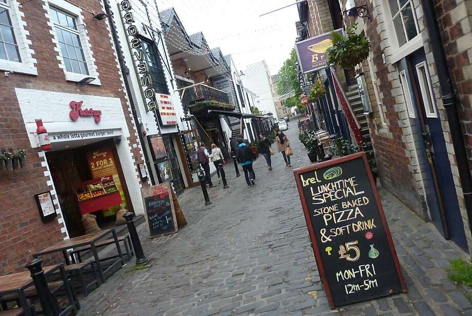 Ashton Lane in Glasgow's West End neighborhood is a popular pedestrian alley lined with funky, alternative cafes, shops, bars and gastropubs. Photo: Spud Hilton, The Chronicle