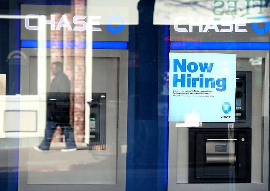 While this bank branch in San Rafael says it's hiring, JPMorgan Chase plans to cut 4,000 jobs this year. A Field Poll finds a dim view of the state's job picture. Photo: Justin Sullivan, Getty Images