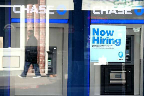 "FILE - FEBRUARY 26: JPMorgan Chase & Co. announced on February 26, 2013 that the company would cut 4,000 jobs this year to trim expenses by $1 billion.  SAN RAFAEL, CA - JANUARY 04: A pedestrian walks by a ""now hiring"" sign that is posted in the window of a Chase bank branch on January 4, 2013 in San Rafael, California. According to a Labor Department December jobs report, the U.S. unemployment remained the same from November at 7.8% as employers added 155,000 jobs in December.  (Photo by Justin Sullivan/Getty Images)"