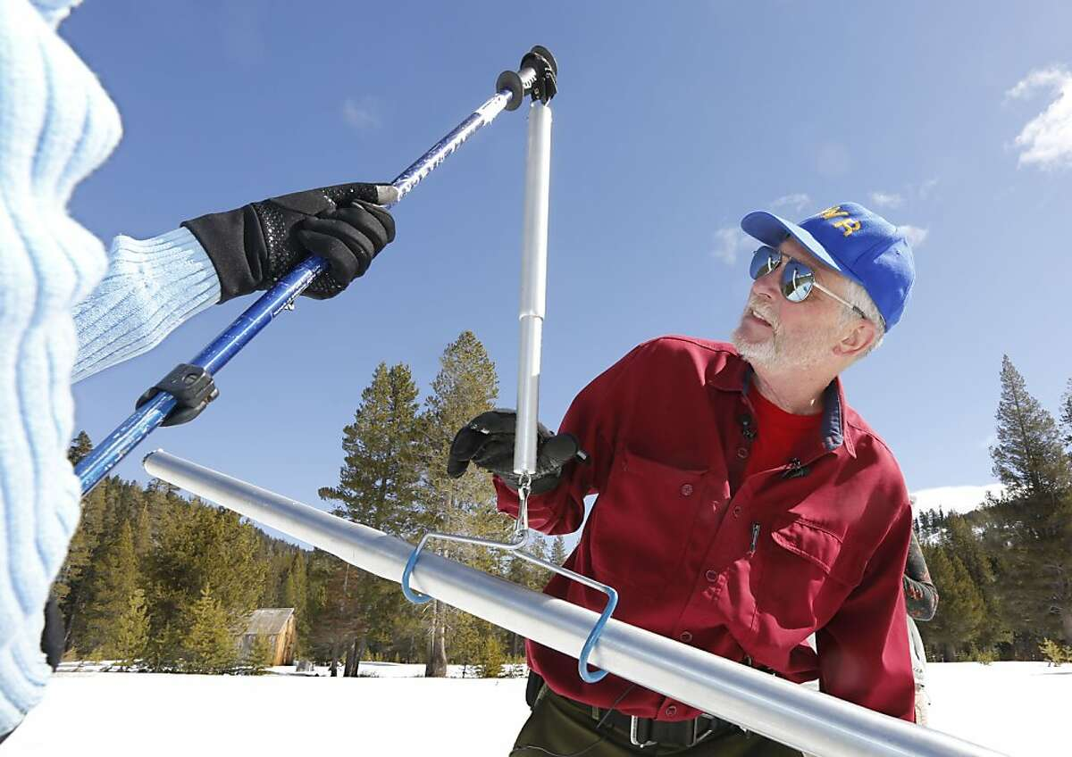 Frank Gehrke, chief of snow surveys for the Department of Water Resources, checks the weight of the snowpack survey tube during the snow survey at Echo Summit Calif., Thursday, Feb. 28, 2013. The survey showed the snow pack to to be 29 inches deep with a water content of 13.4 inches, which is 57 percent of normal for this site at this time of year.(AP Photo/Rich Pedroncelli)