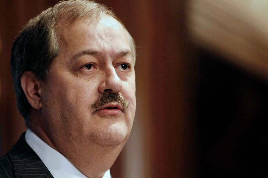 FILE -In this Thursday, July 22, 2010 file photo, Chairman and Chief Executive Officer of Massey Energy Company Don Blankenship speaks at the National Press Club in Washington. David Hughart, a former president of a Massey Energy subsidiary implicated the company's chief executive officer in safety violations as he pleaded guilty Thursday, Feb. 28, 2013, to charges resulting from an investigation into the 2010 explosion at a Massey mine that killed 29 men. The CEO at the time, Don Blankenship, was not mentioned by name. (AP Photo/Jacquelyn Martin, File) Photo: Jacquelyn Martin