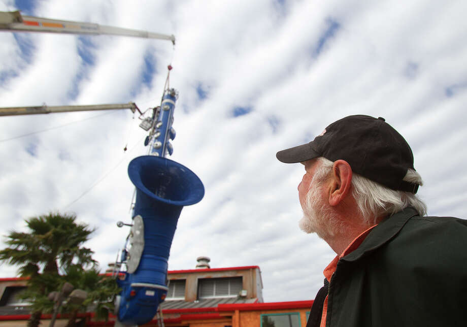 Artist Bob Wade looks at his Smokesax that he built as it is removed from its home at 6025 Richmond, Thursday, Feb. 28, 2013, in Houston. The 70-foot-tall structure is constructed out of car parts, oil field pipes and a surfboard, as well as an entire VW Beetle that forms the U-joint at its base. It's being moved to the The Orange Show Center for Visionary Art to incorporate it into their portfolio of art preservation projects would ensure that this important piece of Texas folk art be taken care of for future generations. Photo: Cody Duty, Houston Chronicle / © 2013  Houston Chronicle