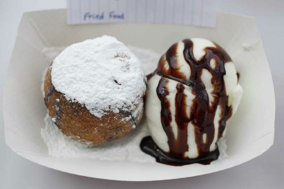 Fried Brownie Ball with ice cream by Custom Confections, which won 2nd place for Best Fried Food on display during the annual  Golden Buckle Foodie Awards at the Houston Livestock Show and Rodeo, Thursday, Feb. 28, 2013. Photo: Karen Warren, Staff / © 2013 Houston Chronicle