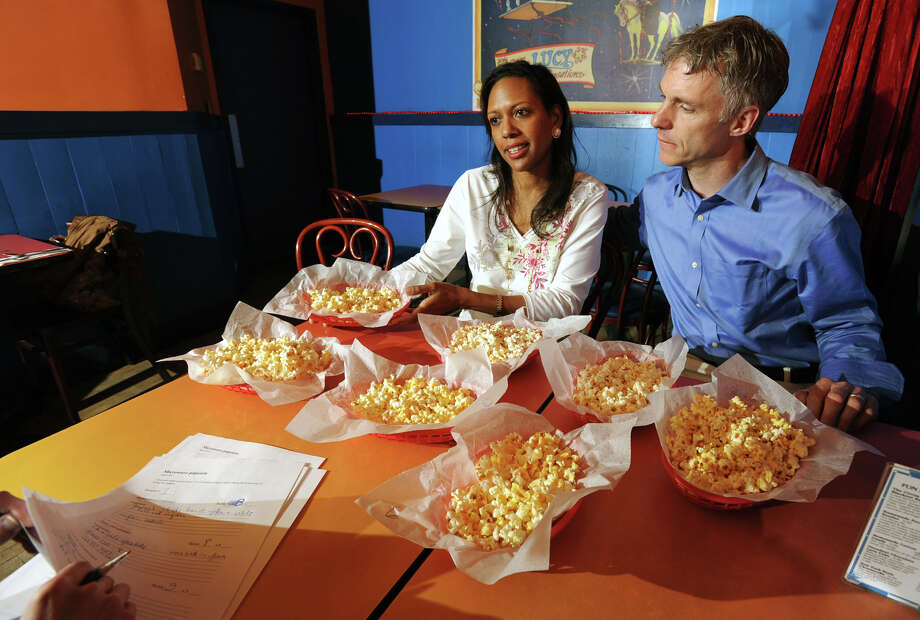 Christel and Colin MacLean, owners of Circus Cafe in Saratoga Springs, N.Y., taste test microwaved popcorn at their restaurant on Friday April 15, 2011. (Lori Van Buren / Times Union) Photo: Lori Van Buren / 00012768A