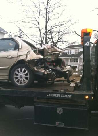 This vehicle shows damage allegedly caused when it was hit by an SUV police said was driven by Officer Max Etienne on Sunday, Feb. 19, 2013. (Courtesy Jenna Hahne)