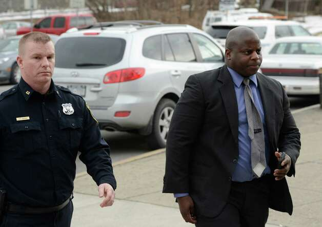 Veteran Albany Police Officer Max Etienne, right arrives at the City Court building at 1 Morton Avenue Monday afternoon, Feb. 19, 2013, in Albany, N.Y., for his arraignment on DWI charges for an incident occurring early Sunday morning in Albany. (Skip Dickstein/Times Union archive) Photo: SKIP DICKSTEIN / 00021219A