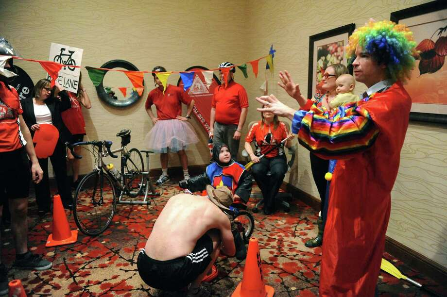 Chris Bowcutt , right, directs a video featuring people doing a variation of the Harlem Shake as a promotion for the for the 2013 Tour de Cure on Thursday Feb. 28, 2013 in Clifton Park, N.Y. (Michael P. Farrell/Times Union) Photo: Michael P. Farrell