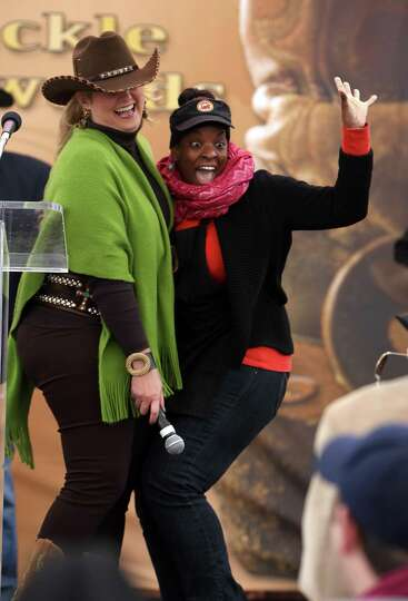 Candace Brooks, right, hugs Michelle Lilie, as Brooks was awarded third place for Harlon's BBQ's Sup