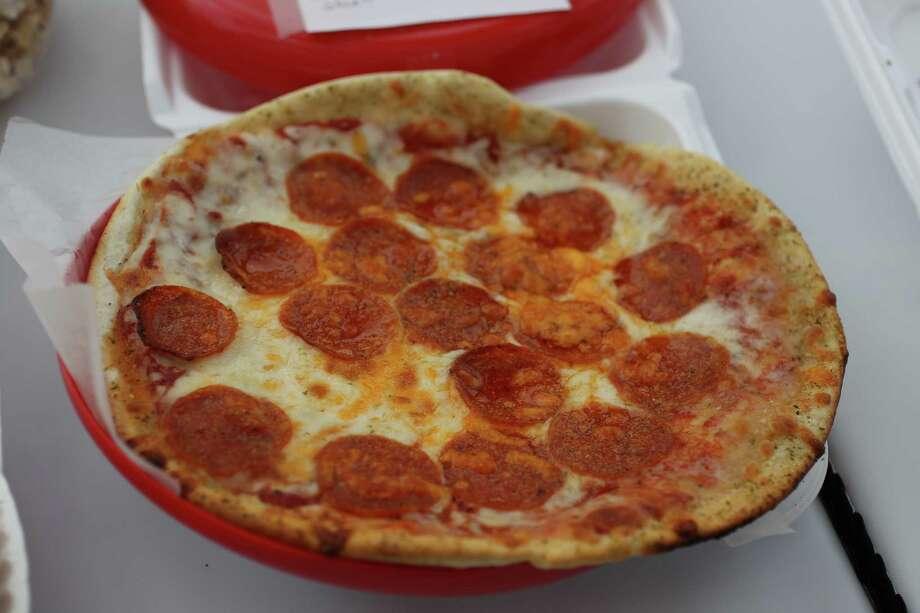 8,000:pizzas eaten at the 2013 Livestock Show and Rodeo Photo: Karen Warren, Houston Chronicle / © 2013 Houston Chronicle