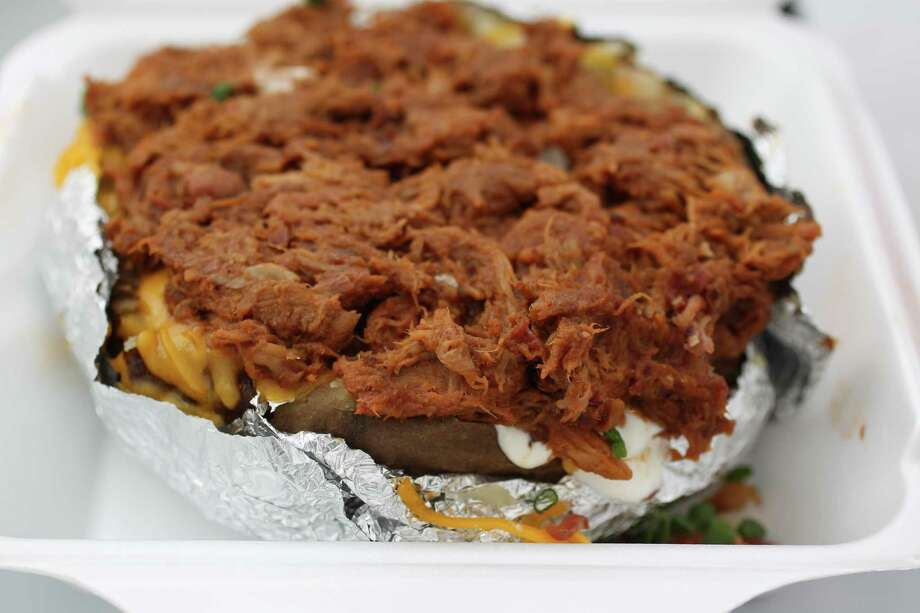 Pulled Pork loaded baked potato by Saltgrass, which won 1st place for Classic Fair Food, on display during the annual Golden Buckle Foodie Awards at the Houston Livestock Show and Rodeo, Thursday, Feb. 28, 2013, in Houston. Photo: Karen Warren, Houston Chronicle / © 2013 Houston Chronicle