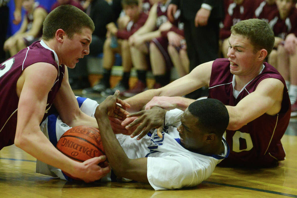 Bethel's Matthew Liquori, left, and teammate Griffin Teed, right, scramble for the ball with Bunnell's Ryan Pittman during Bunnell's 71-61 win in the SWC Boys Basketball Championship game at Bunnell High School in Stratford, Conn. Thursday, Feb. 28, 2013.