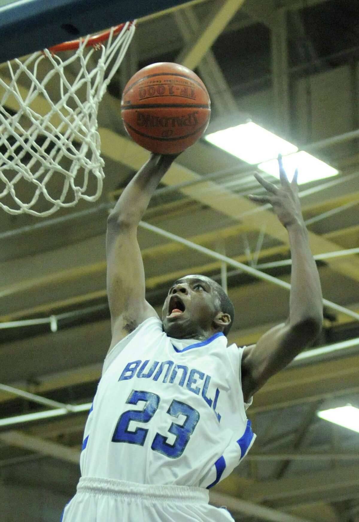 Bunnell's Issac Vann slam dunks during Bunnell's 71-61 win in the SWC Boys Basketball Championship game at Bunnell High School in Stratford, Conn. Thursday, Feb. 28, 2013.