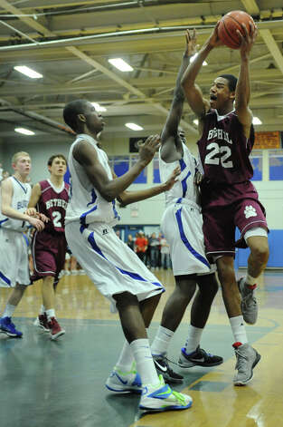 Bethel's Daniel Garvin, right, shoots over Bunnel defenders Adam Samuel, center, and Issac Vann during Bunnell's 71-61 win in the SWC Boys Basketball Championship game at Bunnell High School in Stratford, Conn. Thursday, Feb. 28, 2013. Photo: Tyler Sizemore / The News-Times