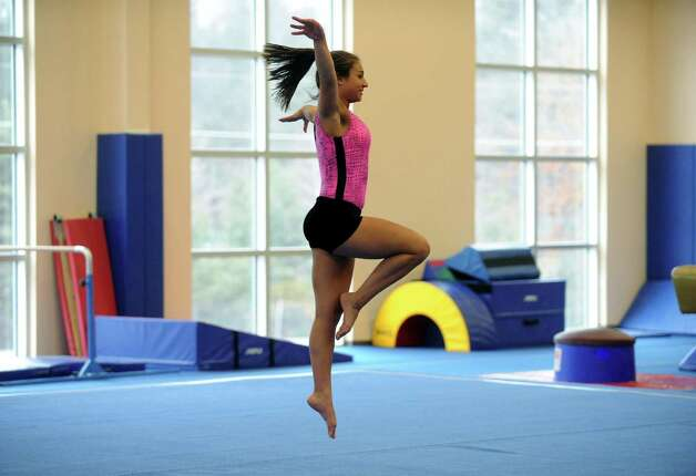 Guilderland High School gymnastics athlete Hailey Marini practices with the Section II team on Tuesday Feb. 26, 2013 in Saratoga Springs, N.Y. (Michael P. Farrell/Times Union) Photo: Michael P. Farrell