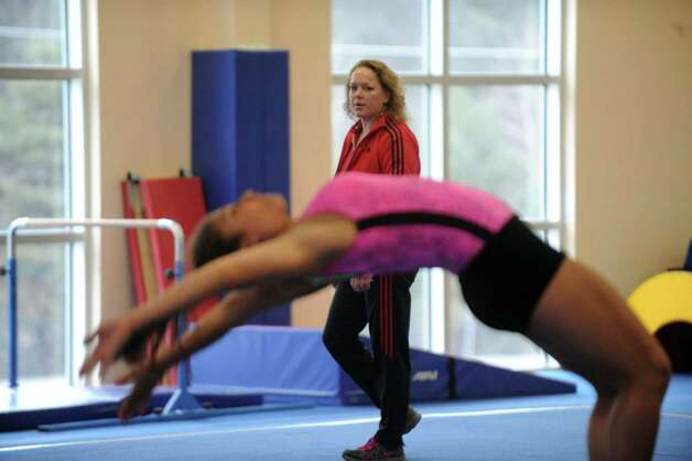 Guilderland High School coach Brenda Goodknight watches as gymnastics athlete Hailey Marini practices with the Section II team on Tuesday Feb. 26, 2013 in Saratoga Springs, N.Y. (Michael P. Farrell/Times Union) Photo: Michael P. Farrell