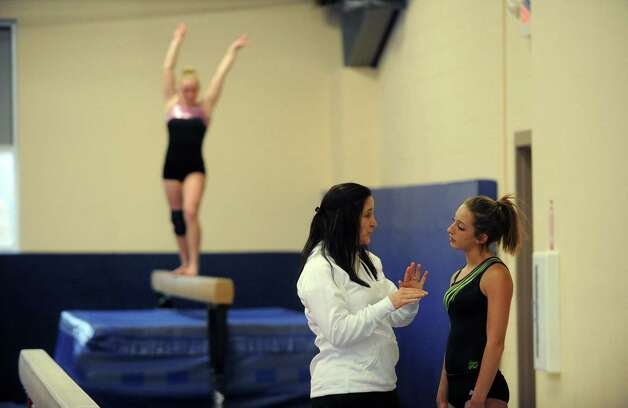 Saratoga High School coach Debbie Smarro talks with gymnastics athlete Kelsey Jackowitz,right, as she practices with the Section II team on Tuesday Feb. 26, 2013 in Saratoga Springs, N.Y. (Michael P. Farrell/Times Union) Photo: Michael P. Farrell
