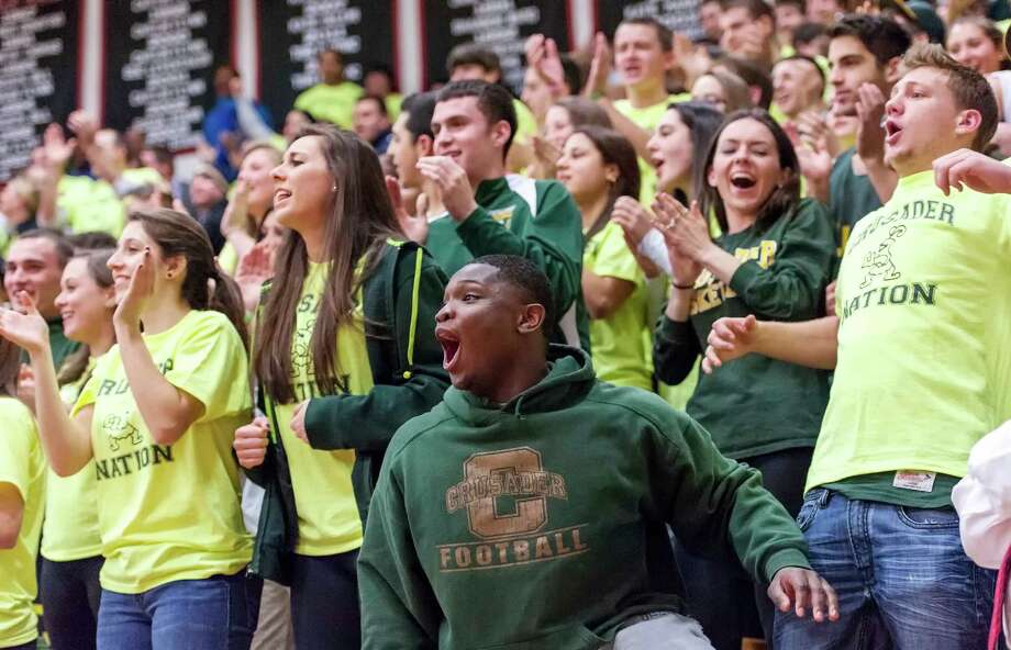 Trinity Catholic high school fans cheering their team on during the FCIAC boy's basketball championship game against Bridgeport Central high school held at Fairfield Warde high school, Fairfield, CT on Thursday February 28th, 2013. Photo: Mark Conrad / Connecticut Post Freelance
