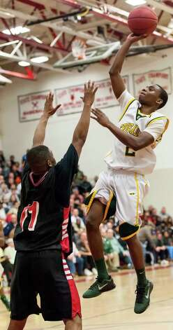 Trinity Catholic high school's Schadrac Casimir goes up for a shot in the FCIAC boy's basketball championship game against Bridgeport Central high school held at Fairfield Warde high school, Fairfield, CT on Thursday February 28th, 2013. Photo: Mark Conrad / Connecticut Post Freelance