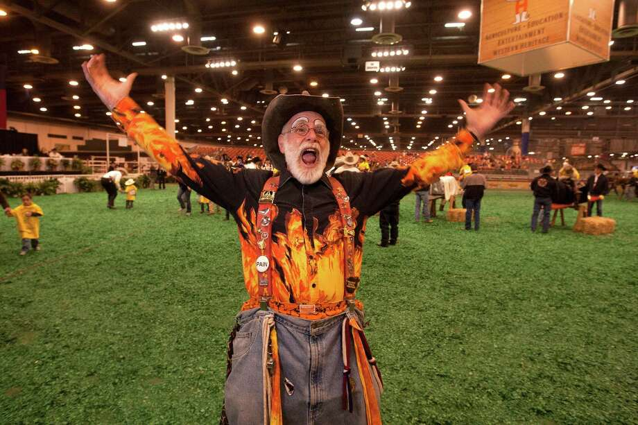 Flame gets the crowd going during the 2013 Lil' Rustlers Rodeo, an event for children with special needs at Reliant Center Thursday, Feb. 28, 2013, in Houston. . Photo: Johnny Hanson, Houston Chronicle / © 2013  Houston Chronicle