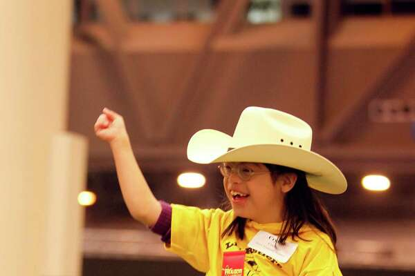 Crystal Cortez, 8, rides a horse at the 2013 Lil' Rustlers Rodeo.