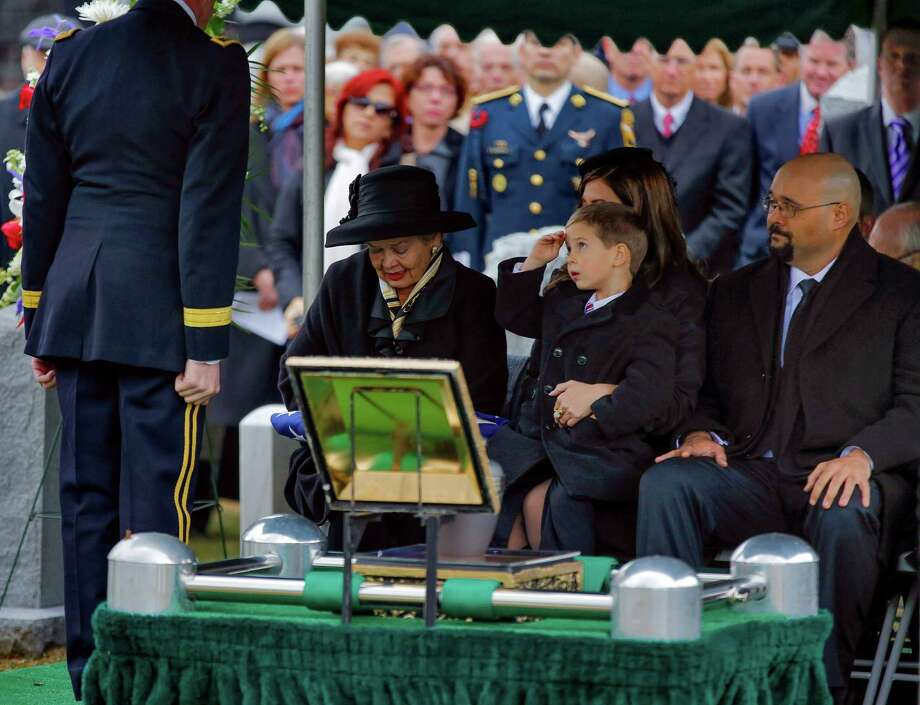 Max Karmazyn, center, sitting next to his grandmother Brenda Schwarzkopf, left, salutes during the burial of his late grandfather, Gen. Norman Schwarzkopf,  at the United States Military Academy on Thursday, Feb. 28, 2013, in West Point, N.Y. Schwarzkopf was 78 when he died of complications from pneumonia on Dec. 27 in Tampa. (AP Photo/Philip Kamrass) Photo: Philip Kamrass