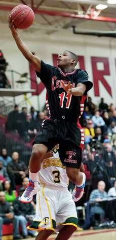 Bridgeport Central high school's Tyler Ancrum goes up for a shot in the FCIAC boy's basketball championship game against Trinity Catholic high school held at Fairfield Warde high school, Fairfield, CT on Thursday February 28th, 2013. Photo: Mark Conrad / Connecticut Post Freelance