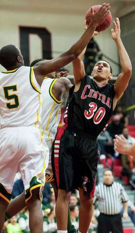Bridgeport Central high school's Marcus Blackwell fights for a rebound in the FCIAC boy's basketball championship game against Trinity Catholic high school held at Fairfield Warde high school, Fairfield, CT on Thursday February 28th, 2013. Photo: Mark Conrad / Connecticut Post Freelance