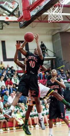 Bridgeport Central high school's ShaQuan Bretoux grabs a rebound in the FCIAC boy's basketball championship game against Trinity Catholic high school held at Fairfield Warde high school, Fairfield, CT on Thursday February 28th, 2013. Photo: Mark Conrad / Connecticut Post Freelance