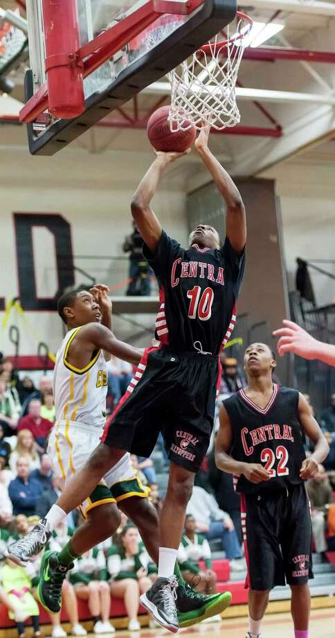 Bridgeport Central high school's ShaQuan Bretoux goes up for a shot in the FCIAC boy's basketball championship game against Trinity Catholic high school held at Fairfield Warde high school, Fairfield, CT on Thursday February 28th, 2013. Photo: Mark Conrad / Connecticut Post Freelance
