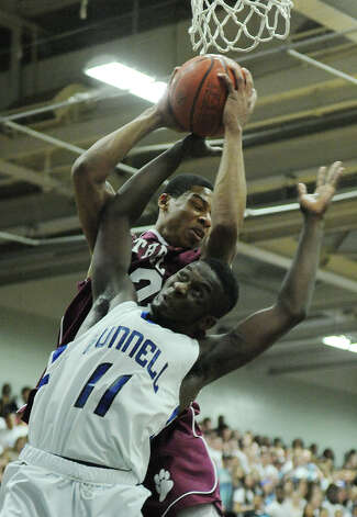 Bunnell's Adam Samuel (11) and Bethel's Daniel Garvin battle for a rebound during Bunnell's 71-61 win in the SWC Boys Basketball Championship game at Bunnell High School in Stratford, Conn. Thursday, Feb. 28, 2013. Photo: Tyler Sizemore / The News-Times
