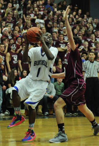 Bunnell's Ryan Pittman, left, shoots against Bethel's James Jerolimo during Bunnell's 71-61 win in the SWC Boys Basketball Championship game at Bunnell High School in Stratford, Conn. Thursday, Feb. 28, 2013. Photo: Tyler Sizemore / The News-Times