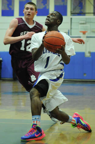 Bunnell's Ryan Pittman, right, drives past Bethel's Matthew Liquori during Bunnell's 71-61 win in the SWC Boys Basketball Championship game at Bunnell High School in Stratford, Conn. Thursday, Feb. 28, 2013. Photo: Tyler Sizemore / The News-Times