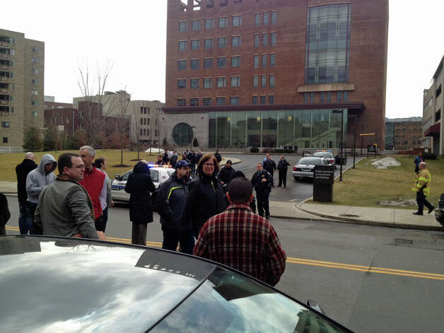 People stand outside state Superior Court in Stamford on Thursday, Feb. 28, 2013, following a bomb threat. Photo: John Nickerson