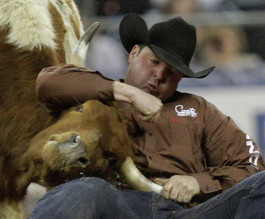 Sean Mulligan of Coleman, OK competes in steer wrestling during round 1 of the Super Series II  of RodeoHouston at the Houston Livestock Show and Rodeo at Reliant Stadium Thursday, Feb. 28, 2013, in Houston. He placed third with a time of 5.7. Photo: Melissa Phillip, Houston Chronicle / © 2013  Houston Chronicle