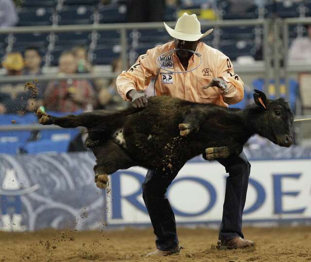 Fred Winfield of Hockley competes in tie-down roping during the RodeoHouston round 1 of Super Series