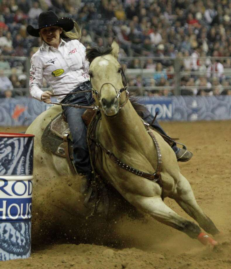 Carlee Pierce of Stephenville rides for a time of 14.47 to place first in barrel racing during round 1 of the Super Series II  of RodeoHouston at Houston Livestock Show and Rodeo at Reliant Stadium Thursday, Feb. 28, 2013, in Houston. Photo: Melissa Phillip, Houston Chronicle / © 2013  Houston Chronicle
