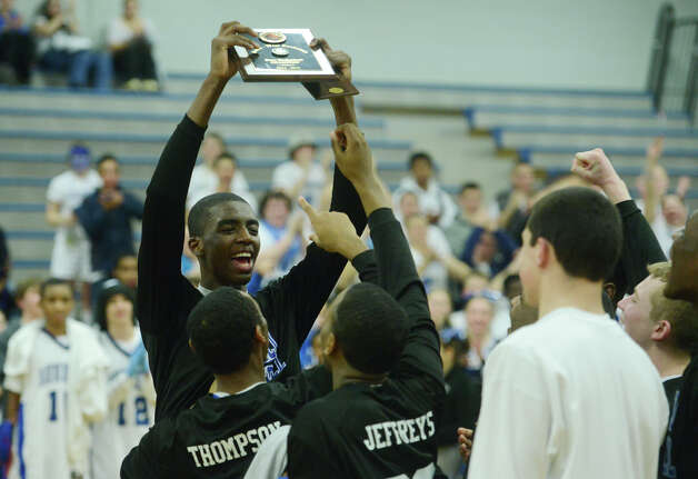 Bunnell celebrates after its 71-61 win over Bethel in the SWC Boys Basketball Championship game at Bunnell High School in Stratford, Conn. Thursday, Feb. 28, 2013. Photo: Tyler Sizemore / The News-Times