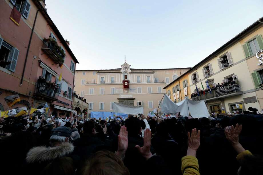 Pope Benedict XVI greets faithful from his summer residence of Castel Gandolfo, the scenic town where Pope Benedict XVI will spend his first post-Vatican days and made his last public blessing as pope,Thursday, Feb. 28, 2013. (AP Photo/Luca Bruno) Photo: Luca Bruno