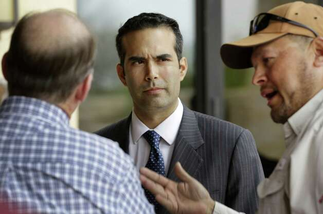 Bush listens as Sam Ruiz (right) makes a point with Bobby Sparks (left), where Bush spoke at the luncheon hosted by the Texas International Produce Association at the Valencia Event Center.