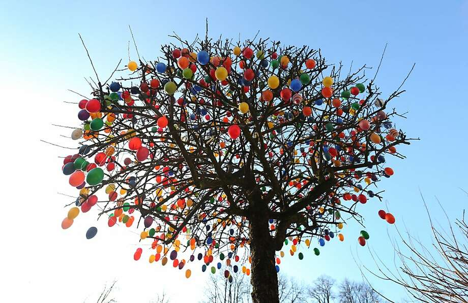 A tree decorated with colorful plastic Easter eggs is seen on February 28, 2013 in Garmisch-Partenkirchen, Germany. Photo: Karl-josef Hildenbrand, AFP/Getty Images