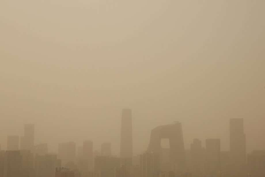 A general view of the skyscrapers in the sandstorm on February 28, 2013 in Beijing, China. Beijing was hit by its first sandstorm of the year while its air quality reached dangerous level on Thursday. Photo: Feng Li, Getty Images